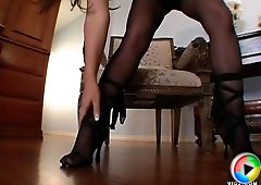 Elegant sensual English maid polishes her man knobs